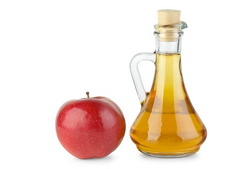 Decanter with apple vinegar and red apple  isolated on the white background
