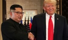 FILE PHOTO: U.S. President Donald Trump and North Korea's leader Kim Jong Un shake hands after signing documents during a summit at the Capella Hotel on the resort island of Sentosa, Singapore